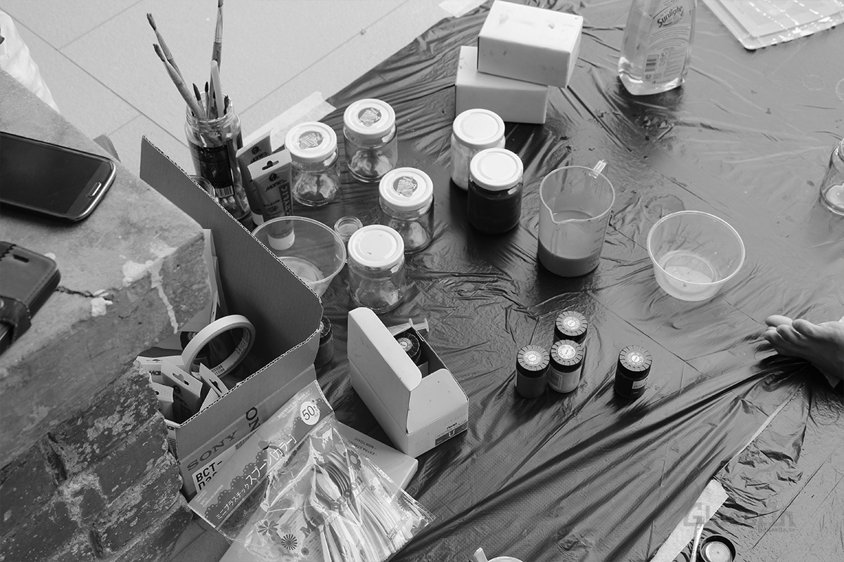 Bottles and tubes of paint for our experimental paint production.